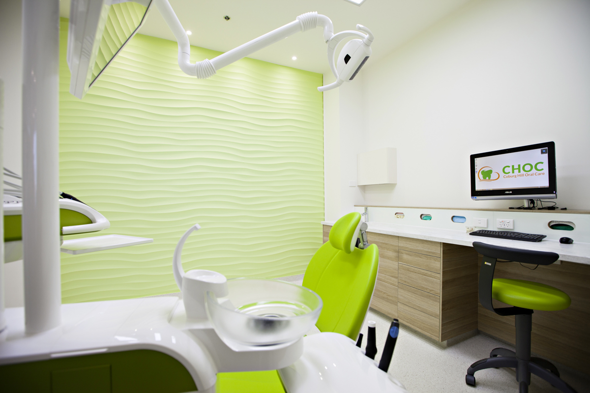Dentist chair and computer station in Coburg Hill white and green themed surgery room