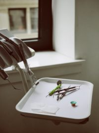 dental instruments on a white tray
