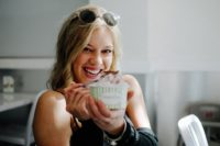 portrait of a young woman smiling and eating ice cream