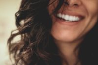 cheeful female smile with white teeth