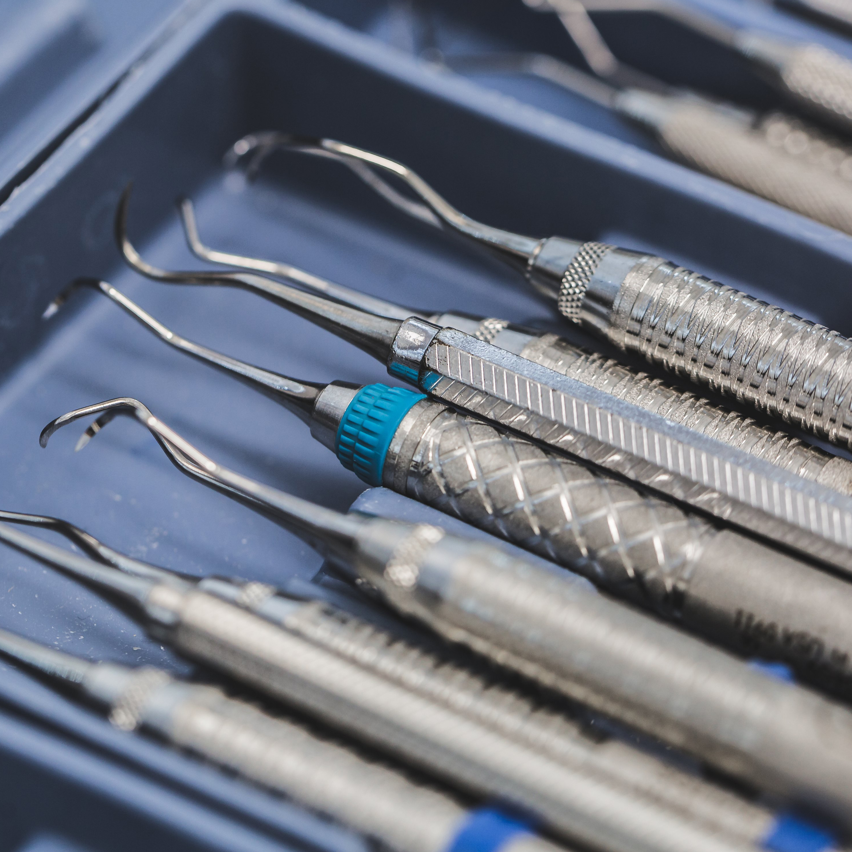 Periodontal probes on a blue tray