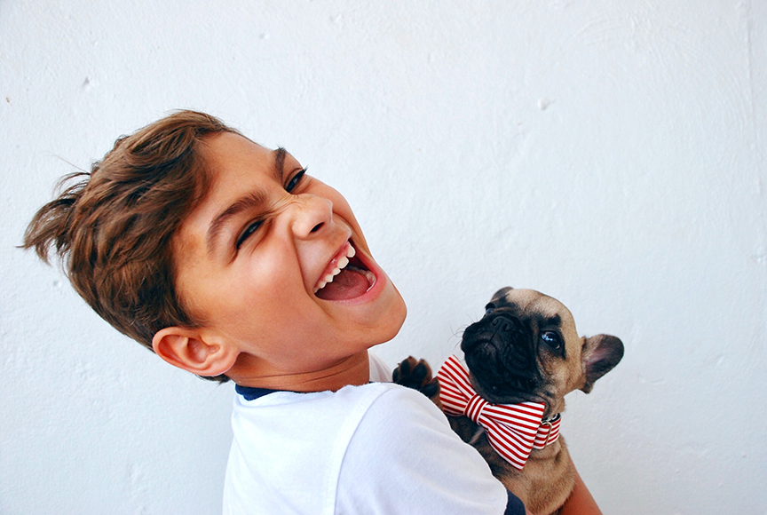 Happy young boy with a small dog