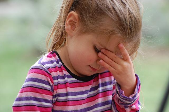 A little girl with headache