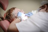 child undergoing deep teeth cleaning