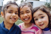 three girls smiling