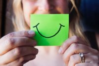 smile on a piece of green paper