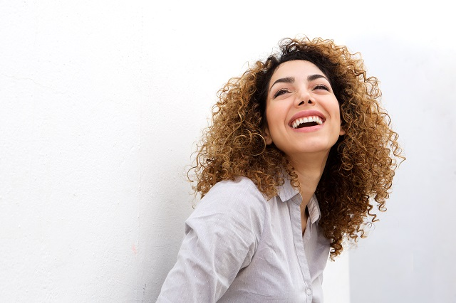 woman smiling against white background