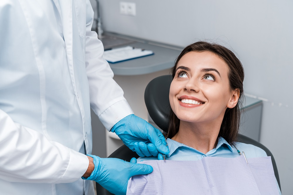 woman smiling up at the dentist